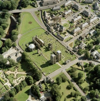 Digital copy of oblique aerial view centred on the remains of the cathedral and Chapter House, taken from the WNW.