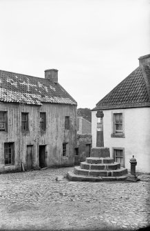 Culross View from the north of The Ark with the market cross in the foreground (before restoration). Scanned image from original glass plate negative. Original envelope annotated by Erskine Beveridge 'Cross Culross'