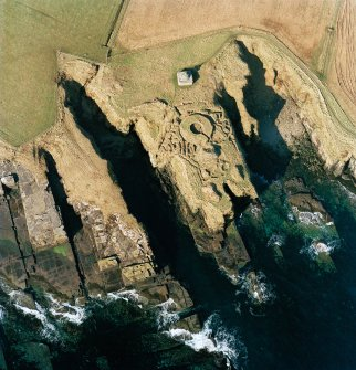 Oblique aerial view of the commemorative monument and the remains of the broch, taken from the E. Photograph taken in2002.