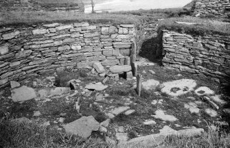 View of excavated broch from south. Original mounted photograph annotated by Erskine Beveridge 'Interior of Nybster Broch, Caithness, from S'. From the RCAHMS Society of Antiquaries of Scotland Collection MS/36/209.