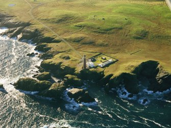 Oblique aerial view centred on the Butt of Lewis lighthouse with the enclosure and lazy beds adjacent, taken from the NNW.