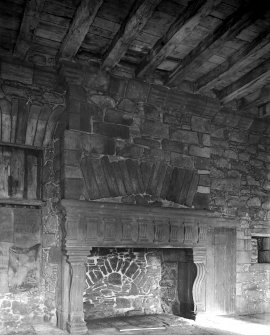 Interior. View of fireplace in hall.