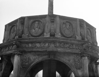 Aberdeen, Castle Street, Market Cross. Detail of Market Cross showing depictions of James IV and Mary, Queen of Scots.