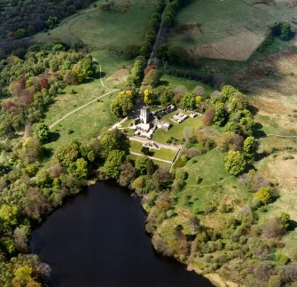 Oblique aerial view centred on the remains of Mugdock castle and tower, taken from the E.