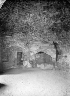 Interior. View of fireplace in SW tower.