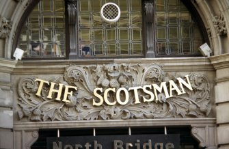 View of carved panel above entrance to The Scotsman Hotel, E side of building (North Bridge).