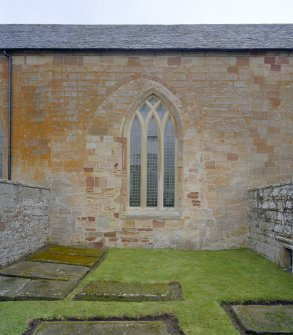 Fearn Abbey.  St. Michael's aisle, view from South showing traceried window and blocked arch.