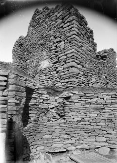 Interior of broch and exterior wall of Laird's House.