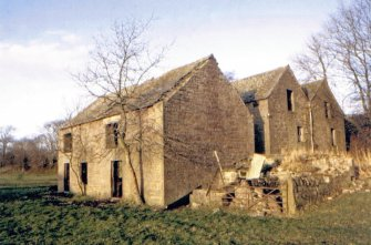Kinnettles Mill: corn mill (rear), threshing mill (fore)  from E, c1979.  Note lade passage between the mills.