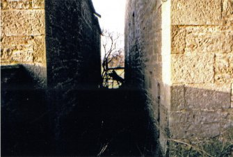 Kinnettles Mill:  view to W through wheelpit (corn mill on right, threshing mill on left), c1979
