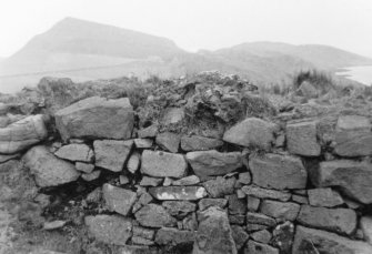 Inner face, SE wall. An image from the Buteshire Natural History Society archaeology photograph album, held at Bute Museum.