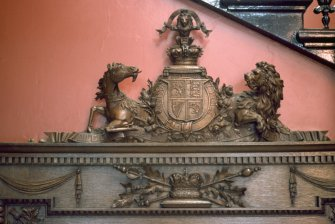 Detailed view of Royal Arms of Scotland at top of panel commemorating Queen Victoria's visit, within entrance hall of Royal Infirmary of Edinburgh.