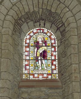 Interior.  Nave, S aisle, 8th  bay from W, detail of stained glass window (John The Baptist)