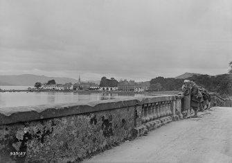 General view towards Inveraray from the Aray Bridge with group of people.