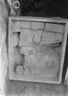 Sculptured stone found before entrance (during reconstruction work).