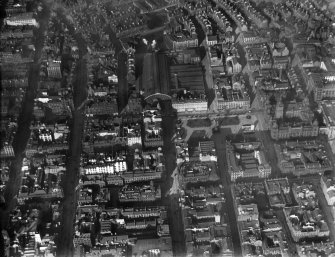 Glasgow, general view, showing George Square and Queen Street Station.  Oblique aerial photograph taken facing north.