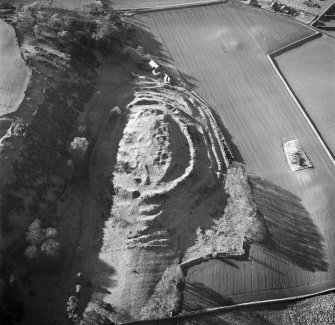 Oblique aerial view centred on the remains of The Chesters fort, Drem, with Dalvreck farmsteading adjacent, taken from the ENE.
