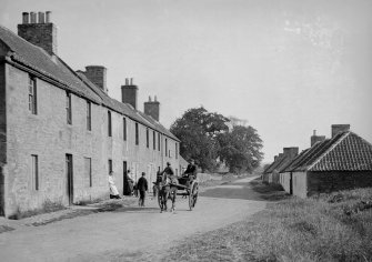 View of West Saltoun Main Street with horse and cart and people.