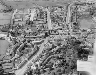Penicuik, general view, showing High Street, John Street and Woodslea.   Oblique aerial photograph taken facing north.