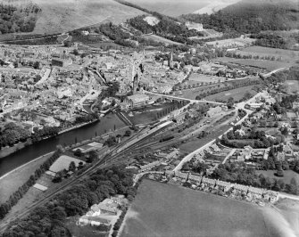 Peebles, general view, showing Tweed Bridge, Weir and Parish Church.  Oblique aerial photograph taken facing east.