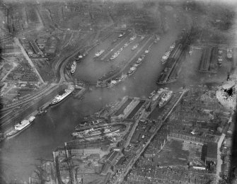 Queen's Dock and Prince's Dock, Glasgow.  Oblique aerial photograph taken facing east.  This image has been produced from a damaged negative.