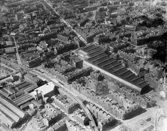 Edinburgh, general view, showing Leith Central Station and Great Junction Street.  Oblique aerial photograph taken facing north.  This image has been produced from a damaged negative.