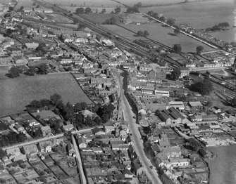 Lockerbie, general view, showing High Street and Holy Trinity Roman Catholic Church.  Oblique aerial photograph taken facing north.