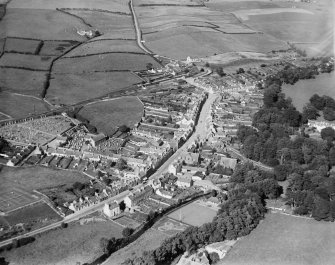 Glenluce, general view, showing Main Street and Old Luce Parish Church, Church Street.  Oblique aerial photograph taken facing north-east.