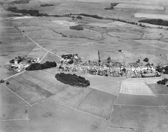 Kirkcowan, general view, showing Main Street and Knockbreck.  Oblique aerial photograph taken facing east.