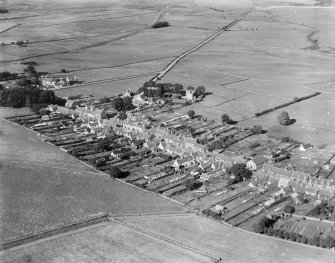 Kirkcowan, general view, showing Main Street and Newton Stewart Road.  Oblique aerial photograph taken facing north-east.