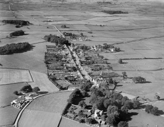 Kirkcowan, general view, showing Main Street and Kirkland House.  Oblique aerial photograph taken facing north.