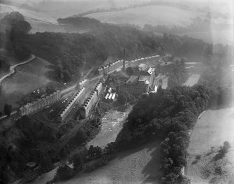 New Lanark, general view, showing Gourock Ropework Co. Ltd. Mills and New Lanark Road.  Oblique aerial photograph taken facing east.
