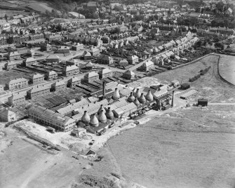 Oblique aerial photograph taken facing south showing Shanks and Co. Ltd. Longpark Pottery Works, Kilmarnock, in 1935 .