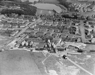 Kilmarnock, general view, showing Shanks and Co. Ltd. Longpark Pottery Works and Campbeltown Drive.  Oblique aerial photograph taken facing east.