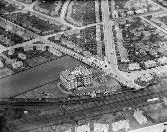 Edinburgh, general view, showing Jenners Furniture Repository, Murrayfield and Saughtonhall Road.  Oblique aerial photograph taken facing north.