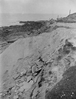 Excavation photograph: Spoil from 19 excavation, dumped over cliff, looking N.