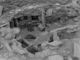 Excavation photograph: House 2, pits and wall recesses in E. end of house. Copy negative 1995. Original print in Print Room.