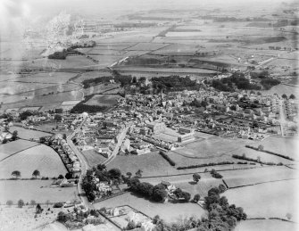 Dalry, general view, showing Dalry Primary School and St Margaret's Church, The Cross.  Oblique aerial photograph taken facing east.  This image has been produced from a damaged negative.