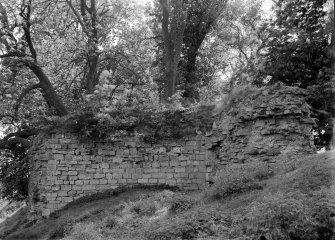 View of masonry of outer face of wall beside circular chamber.