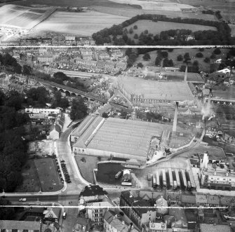 Dunfermline, general view, showing Winterthur Silks Ltd. Canmore Works, Bruce Street and Mill Street.  Oblique aerial photograph taken facing north.  This image has been produced from a crop marked negative.