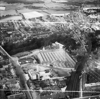Dunfermline, general view, showing Winterthur Silks Ltd. Canmore Works, Bruce Street and Buffies Brae.  Oblique aerial photograph taken facing west.  This image has been produced from a crop marked negative.