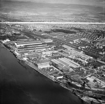 Glasgow, general view, showing Mechans Ltd. Scotstoun Ironworks, South Street and Harland and Wolff Diesel Engine Works, Balmoral Street.  Oblique aerial photograph taken facing north.  This image has been produced from a crop marked negative.
