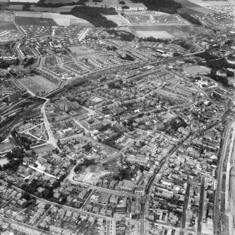 Kirkcaldy, general view, showing Bennochy Cemetery and High Street.  Oblique aerial photograph taken facing north.