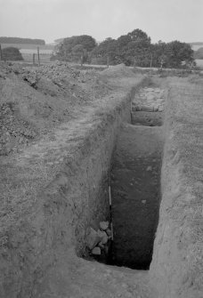 W defences, rampart, Flavian I and Flavian II ditches.