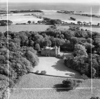 Dunninald Castle, Montrose.  Oblique aerial photograph taken facing east.  This image has been produced from a crop marked negative.