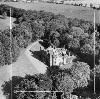 Dunninald Castle, Montrose.  Oblique aerial photograph taken facing north.  This image has been produced from a crop marked negative.