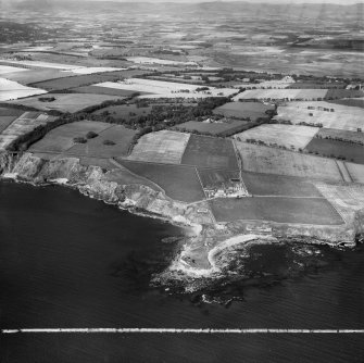 Boddin Point and Mains of Dunninald, Montrose.  Oblique aerial photograph taken facing north-west.  This image has been produced from a crop marked negative.