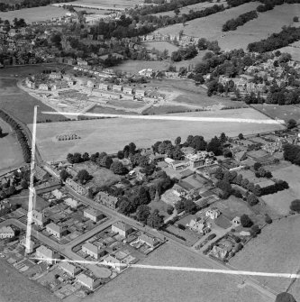 Moffat, general view, showing Warriston School Holmpark, Ballplay Road and Park Circle.  Oblique aerial photograph taken facing north-west.  This image has been produced from a crop marked negative.