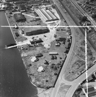 Former Seaplane Base, Stannergate Road, Dundee.  Oblique aerial photograph taken facing west.  This image has been produced from a crop marked negative.
