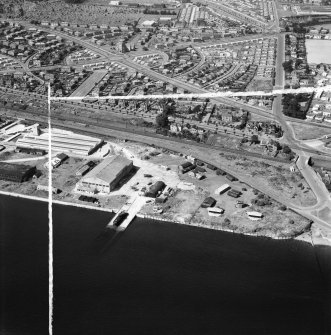 Dundee, general view, showing former Seaplane Base, Stannergate Road and Craigie Avenue.  Oblique aerial photograph taken facing north.  This image has been produced from a crop marked negative.